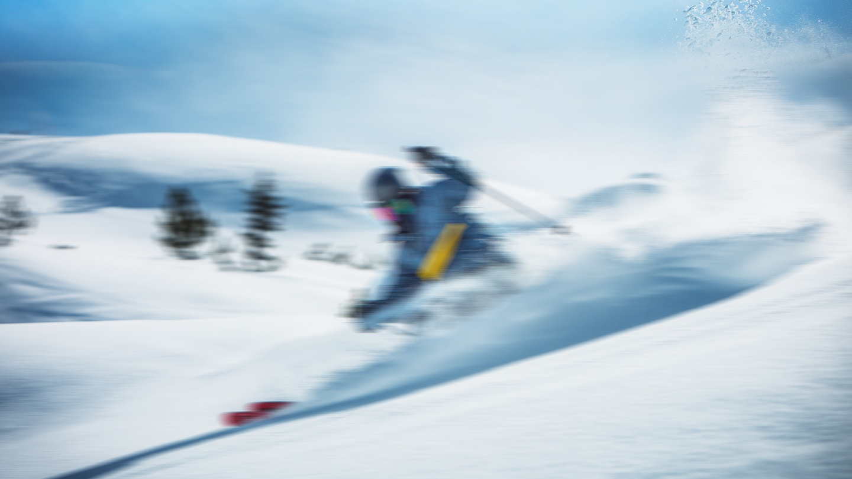 man skiing blurred
